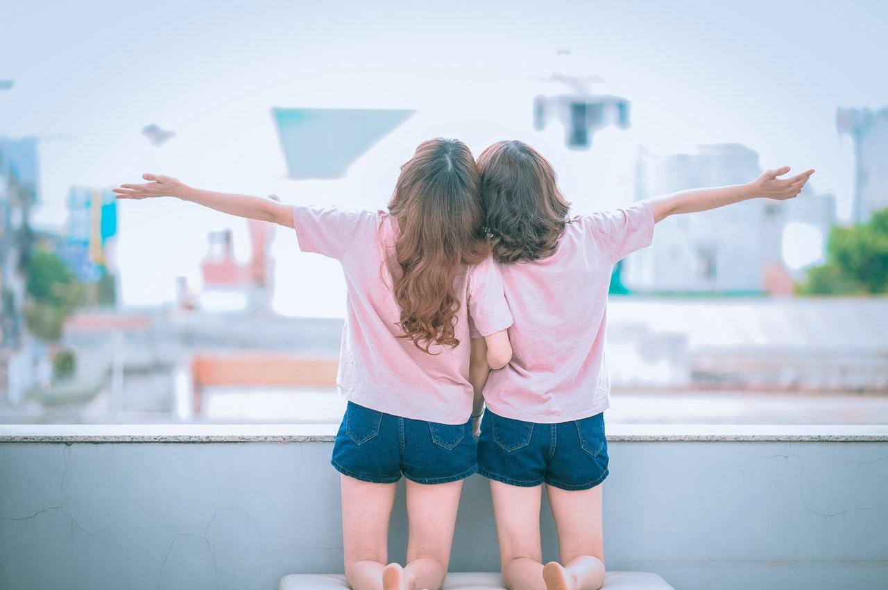 Two kids hanging out Macaroni Kid